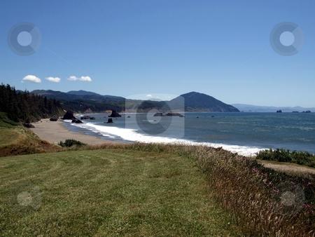 Hillside ocean overlook stock photo, Grassy hillside overlooking beach and ocean in Oregon by Jill Reid