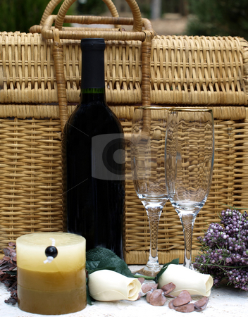 Wine bottle,glasses and picnic basket stock photo, An outdoor setting with wine bottle, glasses and picnic basket by Jill Reid