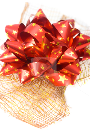 Red bow stock photo, Red bow on decorative golden wire net isolated on white by Natalia Macheda