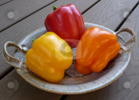 Close-up of red,orange,yellow bell peppers stock photo, Close-up of a grouping of raw red, orange and yellow bell peppers by Jill Reid