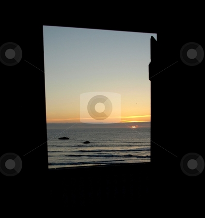 Coastal sunset through the door stock photo, View of the sunset through the open door by Jill Reid