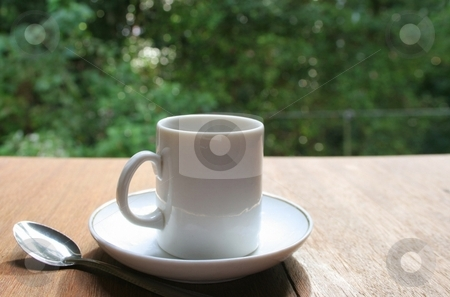 Coffee Cup stock photo, The white coffee cup on the table. by Igor Soares