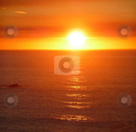 Dramatic blazing sunset over the ocean stock photo, A dramatic blazing orange sunset over the pacific ocean by Jill Reid