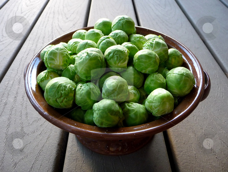 Fresh brussels sprouts in metal bowl stock photo, A bowl full of fresh, raw brussels sprouts by Jill Reid