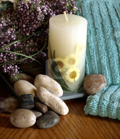 Sunflower candle and pebbles stock photo, A calming settng with sunflower candle and zen pebbles by Jill Reid