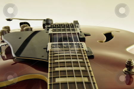 Jazz guitar detail stock photo, Detail of a red jazz guitar isolated on white background by Nils Volkmer