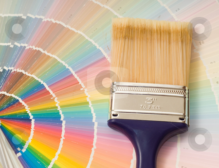 Paint Color Guide stock photo, Closeup view of a paint color guide along with a 3 inch brush by Richard Nelson