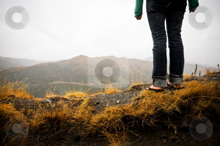Discover the outdoors stock photo, A girl stands with a view from a steep vantage point by Angus Benham