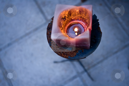 Party time stock photo, A rustic old candle is lit at a function venue by Angus Benham