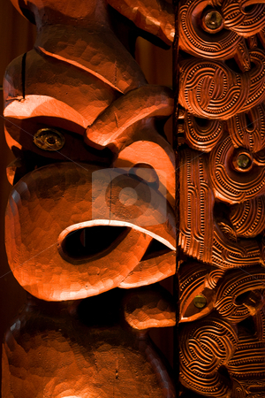 Maori carving stock photo, A dramatically lit Maori carving by Angus Benham