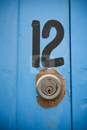 Number 12 stock photo, The number twelve panited on a boat shed door by Angus Benham