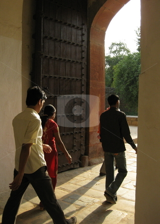 Walking into the Future stock photo, Young Indians walking through an old doorway at Humyan's tomb, New Delhi, India by Colin Elves