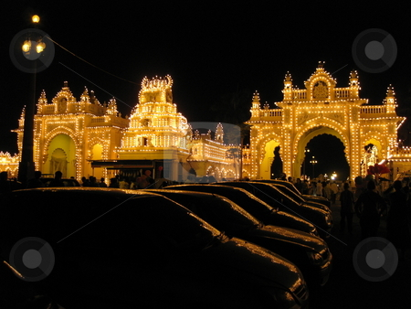 Car reflections, illuminated gate stock photo, The illuminated gate of the Mysore Palace, reflected in Car windows by Colin Elves