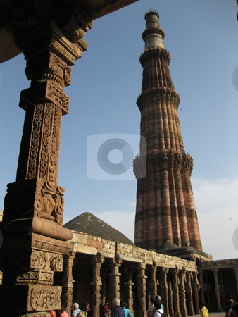 Qutub Minar  stock photo, The Qutub Minar, New Delhi, Framed by the pillars and halls of the nearby ruined mosque by Colin Elves