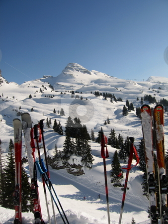 Ski Poles Alps stock photo, Skis, Ski poles and a view of the French Alps by Colin Elves