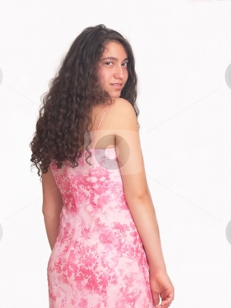 Pretty young girl  stock photo, An pretty young girl from the backside is turning her head back in an nice pink dress on white background. by Horst Petzold