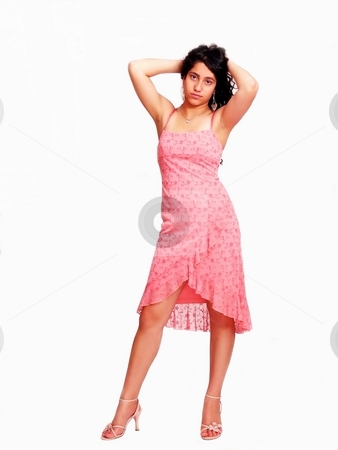 Girl in pink dress   stock photo, An beautiful young girl is standing in her high heels in an nice pink dress holding with both hands her long dark hair behind her head, over white. by Horst Petzold