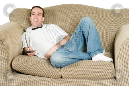 Man Watching TV stock photo, A young man relaxing on a couch and watching tv by Richard Nelson