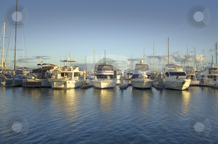 Golden Marina stock photo, Golden light from sunrise breaks over the marina. by Brett Mulcahy