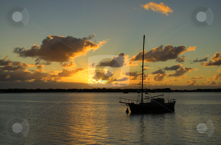 Old Ketch Sunrise stock photo, Sunrise breaks over classic old yacht in the still of the morning. by Brett Mulcahy