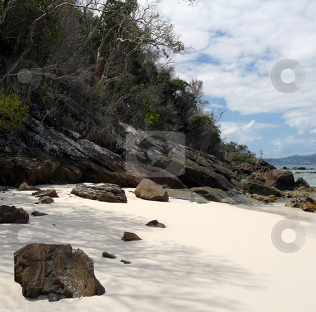 Secluded shady and sandy tropical beach stock photo, Secluded cove on shady and sandy tropical beach by Jill Reid