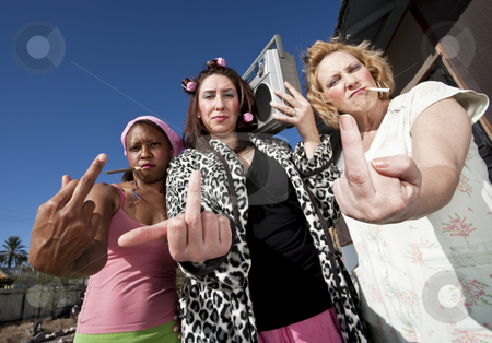 Three Trashy Women making a Rude Gesture stock photo, Portrait of three trashy women outdoors making a rude hand gesture by Scott Griessel