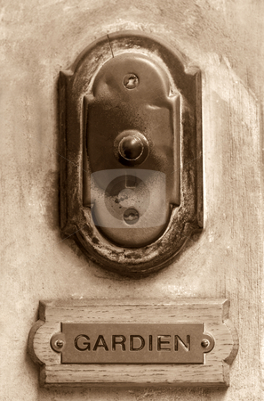 Old doorbell stock photo, Old French doorbell sepia toned with concierge label by Laurent Dambies