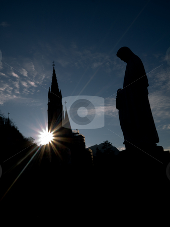 Lourdes basilica stock photo, Silhouette of the Basilica of the Immaculate Conception in Lourdes with statue of the virgin Mary by Laurent Dambies