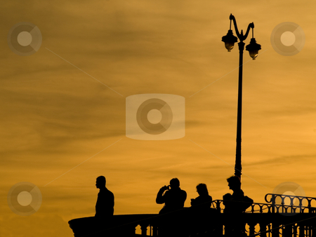 Observation desk at twilight stock photo, Group of people at an observation desk at twilight by Laurent Dambies