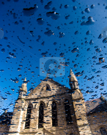Church reflection stock photo, Church reflection on blue metallic surface with rain drops by Laurent Dambies