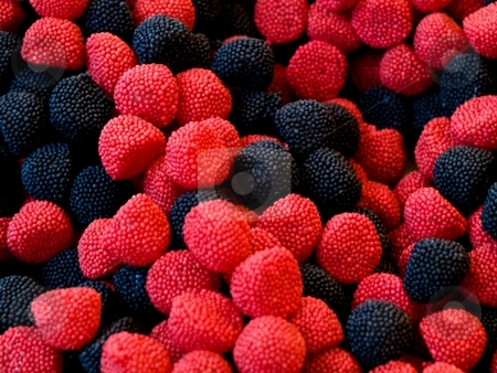 Candy fruits stock photo, Macro of black and red candy fruits by Laurent Dambies