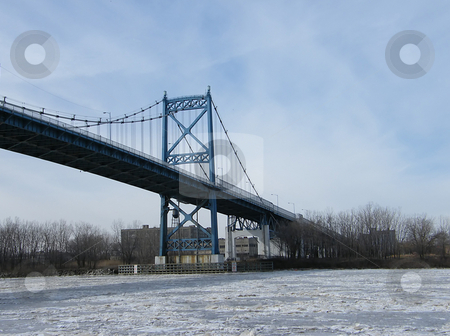 Anthony Wayne Suspension Bridge stock photo, Anthony Wayne Suspension Bridge also known as The High Level Bridge crossing Maumee River in Winter. The bridge was built in 1931. The RIver's surface is frozen. Photo taken at International Park in Toledo Ohio. The bridge connects the East Side of Toledo to other (main) side of the city. by Dazz Lee Photography