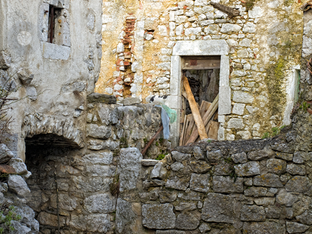 Cat and ruins stock photo, Stone ruins of an abandoned Mediterranean village. by Sinisa Botas