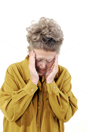 Senior woman with a headache. stock photo, Senior woman with gray hair and an dark yellow jacket holding her head with a teripple headache. On white background. by Horst Petzold