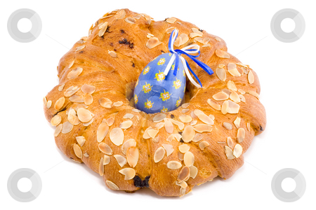 Easter Wreath with an Easter Egg stock photo, Easter pastry wreath with a blue easter egg in it by Petr Koudelka