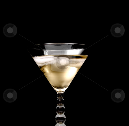 Champagne in glass stock photo, Champagne in glass on black background by John Teeter