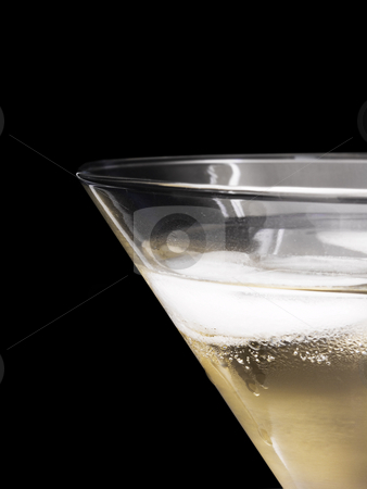 Ice in champagne stock photo, Ice in glass of champagne on black background by John Teeter