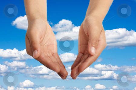 Two open hands stock photo, Hands open in religious prayer against sky background by Christopher Meder