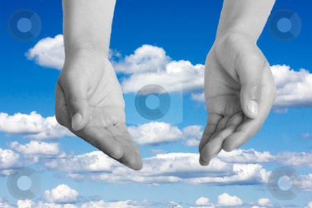 Hands open in religious prayer  stock photo, Hands open in religious prayer against sky background by Christopher Meder