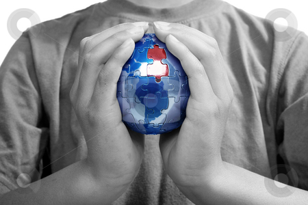 The Missing Piece, Blue Earth stock photo, Earth puzzle, held by a young boy looking for solution by Christopher Meder