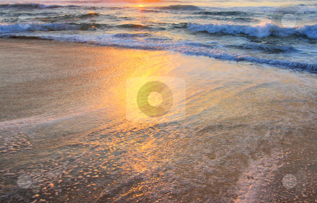 Wave Background stock photo, Serene wave background image, against a sunrise by Christopher Meder