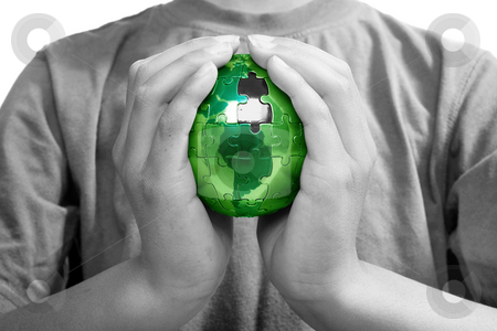 The Missing Piece, Green Energy stock photo, Earth puzzle, held by a young boy looking for solution by Christopher Meder