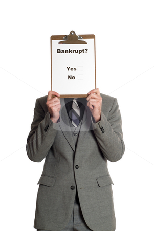 Bankrupt stock photo, Businessman wearing a grey suit is holding a survey in front of his head that is asking people if they are bankrupt or not, isolated against a white background by Richard Nelson