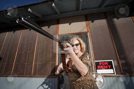 Woman on front proch with rifle stock photo, Blonde woman on her front porch with a rifle by Scott Griessel