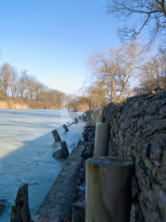 Winter - Icy cold frozen lake  stock photo, Winter - Icy cold frozen  lake by Phillip Dyhr Hobbs