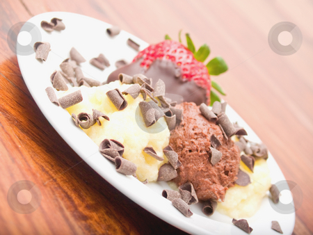 Delicious icecream dessert on white plate stock photo, Delicious icecream  dessert on white plate by Phillip Dyhr Hobbs