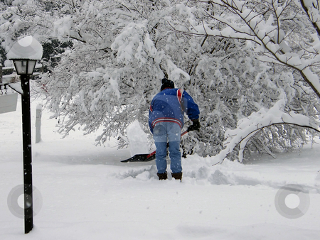 Man Shoveling Snow stock photo, Man Shoveling Snow after a snow storm. by Dazz Lee Photography