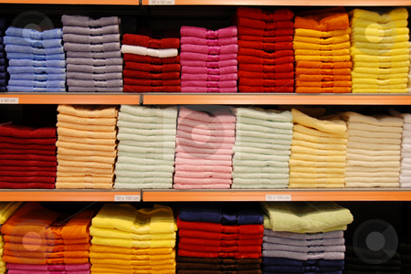 Colorful towels stock photo, New colorful towels stacks on shelves in store by Julija Sapic