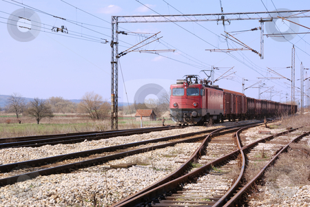 Train stock photo, Red old train on a railroad passing by. by Ivan Paunovic