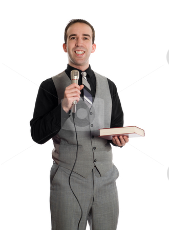Smiling Preacher stock photo, A smiling young preacher holding a microphone and a bible, isolated against a white background by Richard Nelson